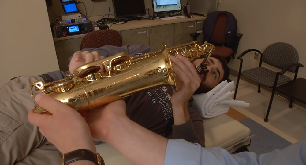 Musician play saxophone during brain his own brain surgery