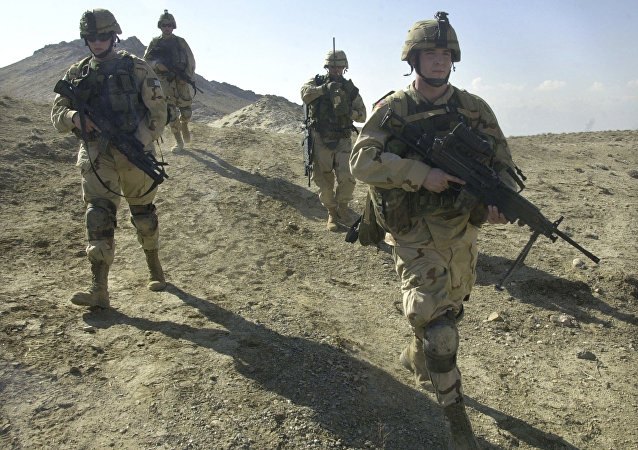 U.S. soldiers patrol the perimeter of a weapons cache four miles of the US military base in Bagram, Afghanistan (File)