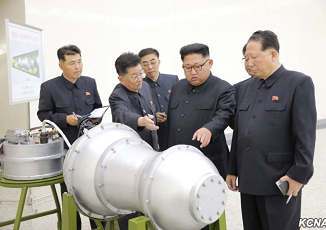 DPRK state-run media outlet KCNA September 3, 2017, handout purporting to show Pyongyang leader Kim Jong-un viewing newly developed miniaturized hydrogen bomb capable of being mounted on ICBM. // KCNA handout