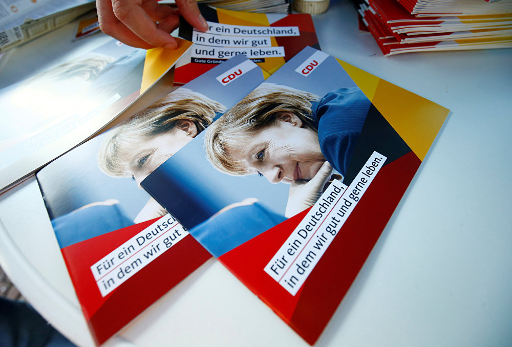 Brochures, showing German Chancellor Angela Merkel, top candidate of the Christian Democratic Union Party (CDU) are seen during an election rally for the upcoming federal elections in Gelnhausen, near Frankfurt, Germany August 14, 2017