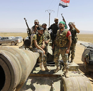 Syrian army fighters stand guard in the Qara area, in Syria's Qalamoun region (File)