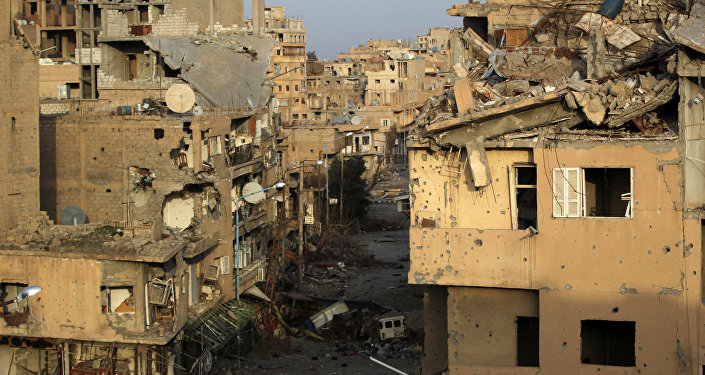 A view shows damaged buildings in Deir ez-Zor, eastern Syria February 19, 2014