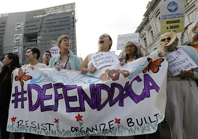 Supporters of the Deferred Action for Childhood Arrivals (DACA) yell during a protest outside of the Federal Building in San Francisco