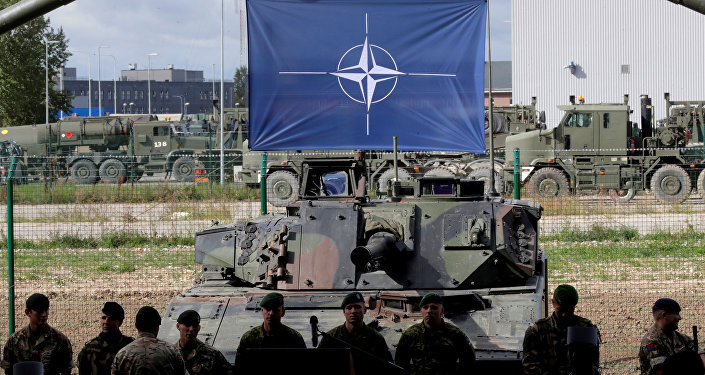 NATO soldiers wait for the alliance's Secretary General Jens Stoltenberg visit in Tapa military base, Estonia September 6, 2017