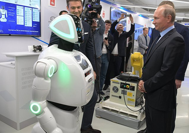 Russian President Vladimir Putin views a showroom of small and medium-size businesses engaged in 'digital economy' as he visits the ER-Telecom Holding in Perm