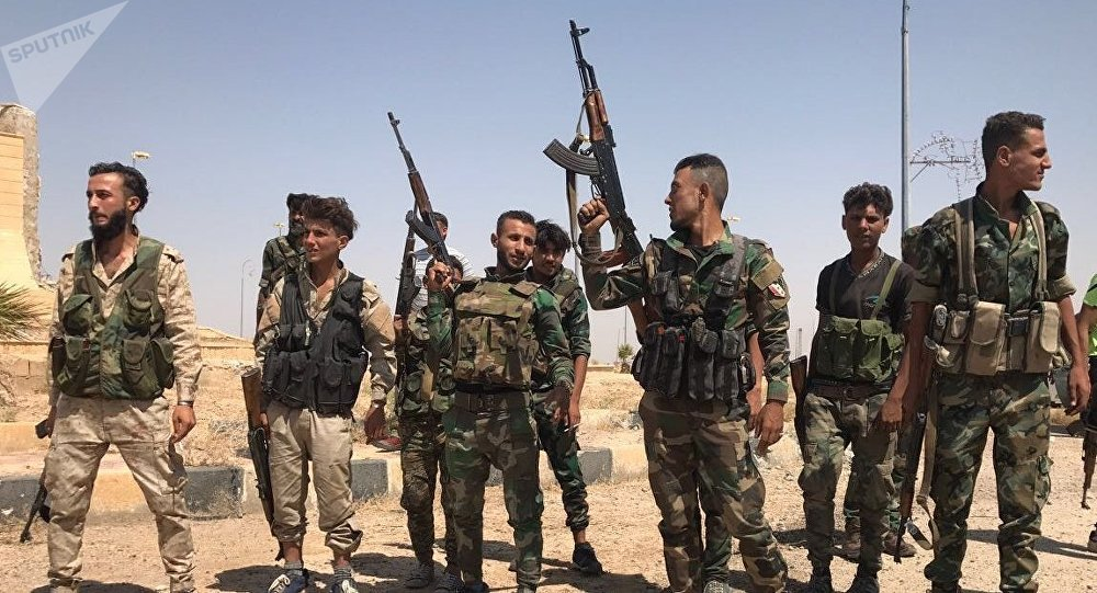 Troops of the Syrian 5th Army Corps join Syrian Army units in the south of Deir ez-Zor following the breaking of the ISIL blockade at the main entrance to the city in the south. File photo