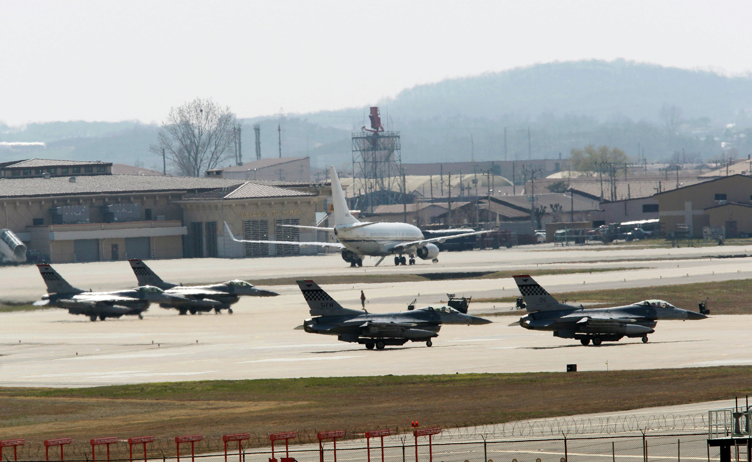 US Air Force F-16 fighter jets wait to take off from a runway during a military exercise at the Osan US Air Base in Osan, South Korea
