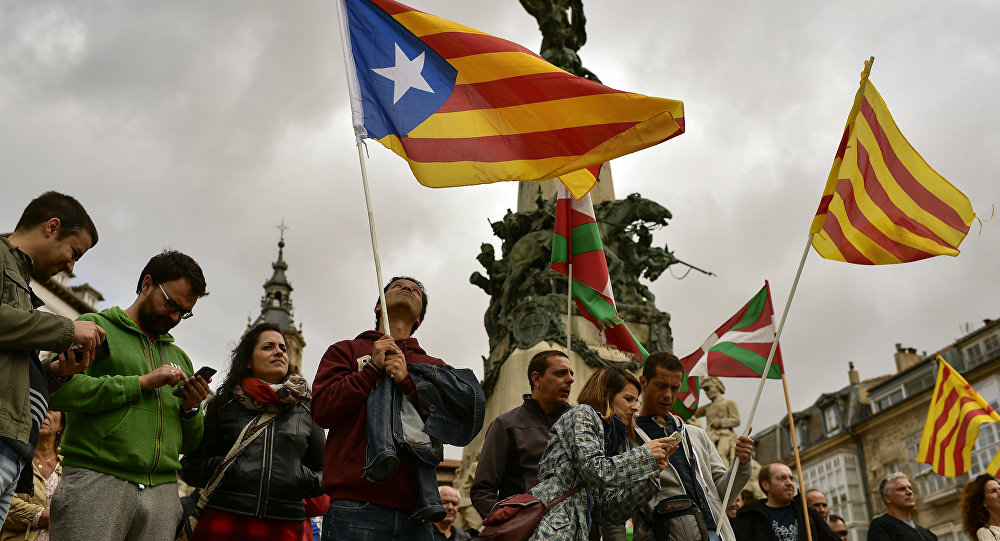 Pro independence supporters wave estelada or pro independence flags during a rally in support for the secession of the Catalonia region from Spain, in Vitoria, northern Spain, Saturday, Sept. 9, 2017