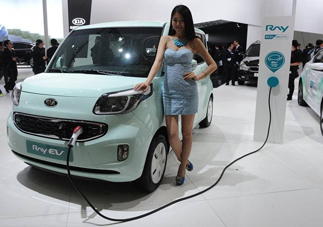 A model poses next to a KIA Ray EV electric car on media day at the Shanghai auto show in Shanghai (File)