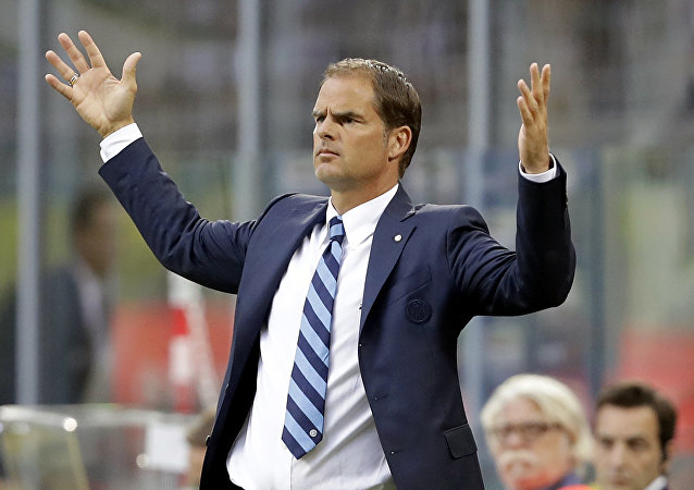Inter Milan coach Frank de Boer opens his arms during the Serie A soccer match between Inter Milan and Juventus at the San Siro stadium in Milan, Italy, Sunday, Sept. 18, 2016.