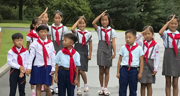 Children at the one of the Pyongyang's streets