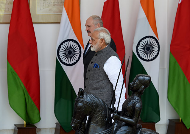 Indian Prime Minister Narendra Modi (R) walks with President of Belarus Alexander Lukashenko before their meeting in New Delhi on September 12, 2017