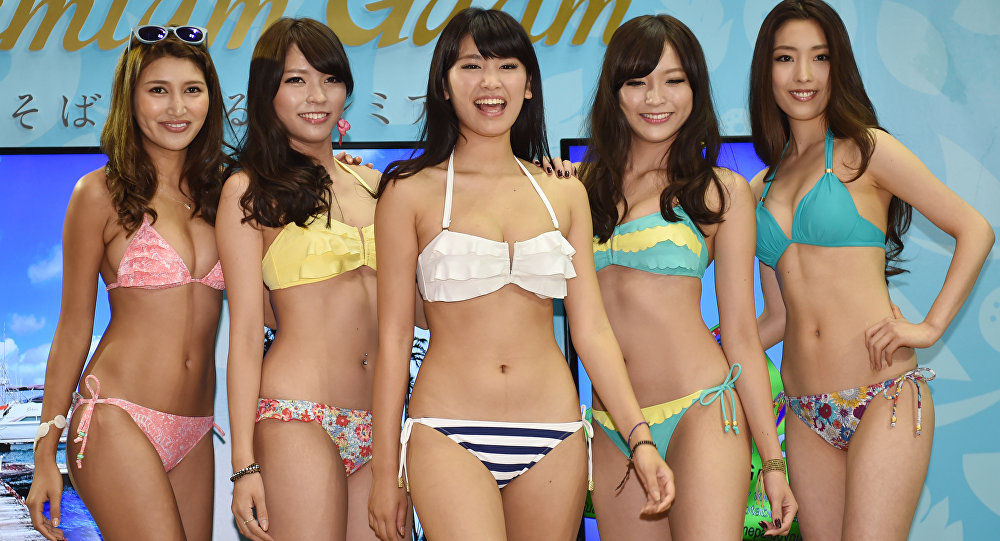 Japanese apparel maker San-ai's campaign girl Ikumi Hisamatsu (C) and models display the company's latest swimsuits during a collection supported by the Guam Visitors Bureau as part of the Tourism EXPO Japan, in Tokyo. (File)
