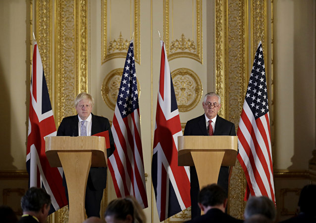 Britain's Foreign minister Boris Johnson and US Secretary of State Rex Tillerson take part in a joint press conference after their meeting on Libya, at Lancaster House in London