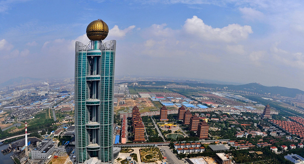 This aerial photo taken on September 25 shows the Longxi International Hotel, standing at 328 metres (1,082-feet) high and costing 470 million USD to build, in Huaxi, which is still classed as a village in east China's Jiangsu province
