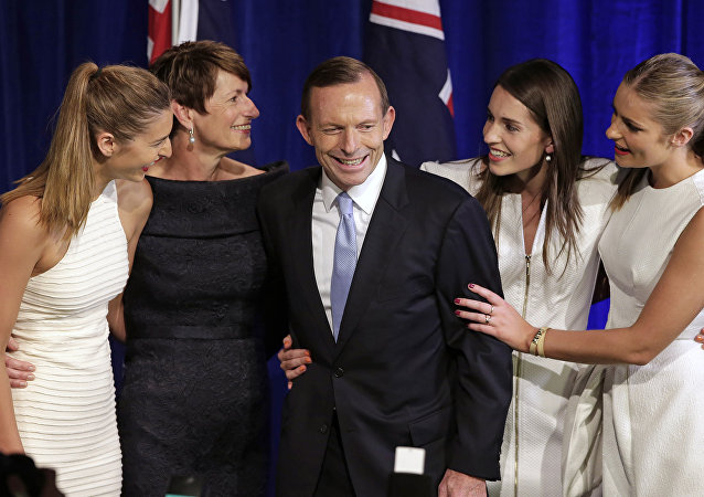 Australian opposition leader Tony Abbott, third left, and his daughters Frances, left, Louise, second right, and Bridget, right, and his wife Margaret, second left, come to the stage to celebrate his election victory in Sydney, Saturday, Sept. 7, 2013, following his win in Australia's national election.