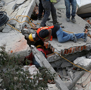 Rescue personnel search for people among the rubble of a collapsed building after an earthquake hit Mexico City, Mexico September 19, 2017