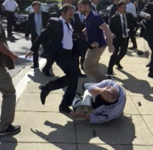 FILE- In this file frame grab from video provided by Voice of America, members of Turkish President Recep Tayyip Erdogan's security detail are shown violently reacting to peaceful protesters during Erdogan's trip last month to Washington