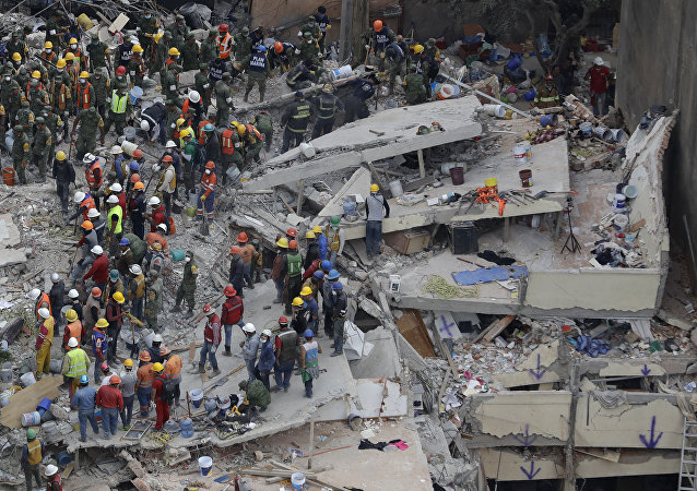 Rescue workers search for people trapped inside a collapsed building in the Del Valle area of Mexico City, Wednesday, Sept. 20, 2017.