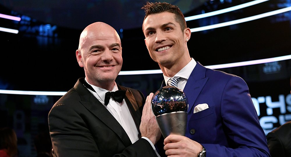 Real Madrid and Portugal's forward and winner of The Best FIFA Men's Player of 2016 Award Cristiano Ronaldo (R) poses with FIFA president Gianni Infantino following The Best FIFA Football Awards 2016 ceremony, on January 9, 2017 in Zuric