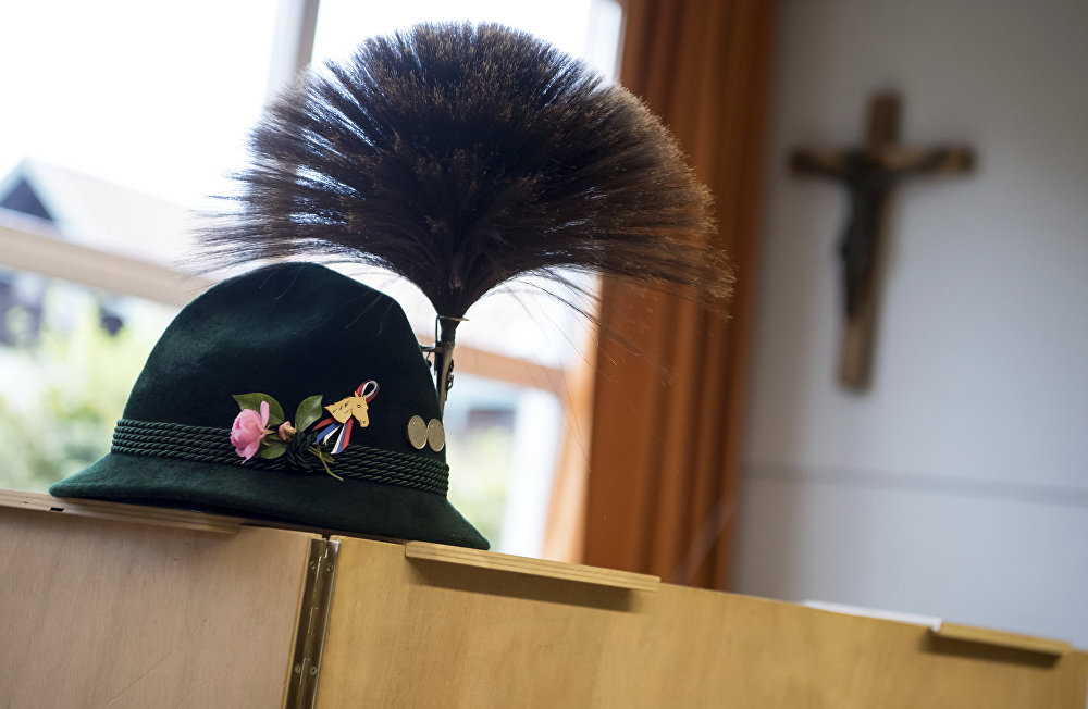 A traditional Bavarian hat with a chamois hair decoration sits on a polling booth during the German parliament election in Unterwoessen, southern Germany, Sunday, Sept. 24, 2017