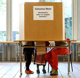 People in traditional Bavarian costumes vote in the general election (Bundestagswahl) in Munich, Germany, September 24, 2017