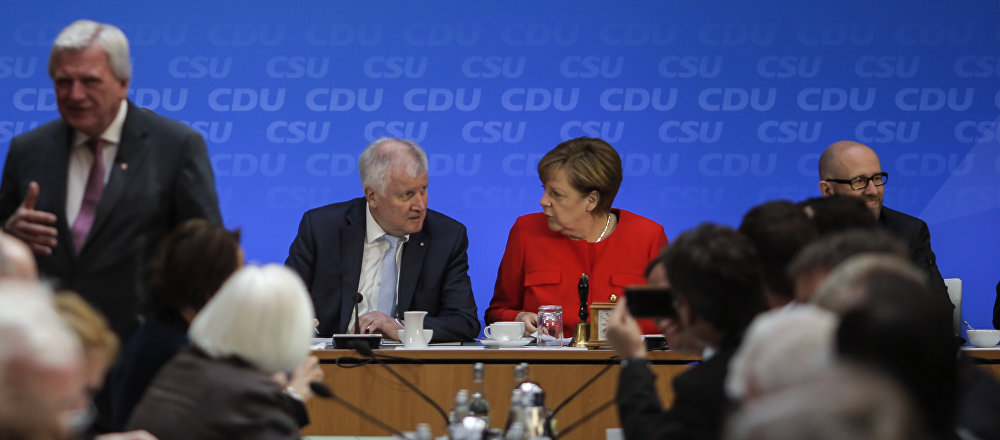 German Chancellor and Christian Democratic Union, CDU, party chairwoman Angela Merkel, center right, and Bavarian state governor and Christian Social Union, CSU, party chairman Horst Seehofer, center left, attend a parties leaders meeting to pass a joint program for Germany's upcoming general elections in Berlin, Monday, July 3, 2017.