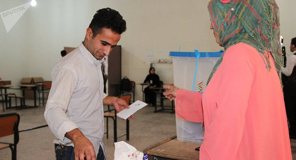 Voting at a polling station in the city of Kirkuk during an independence referendum for Iraqi Kurdistan