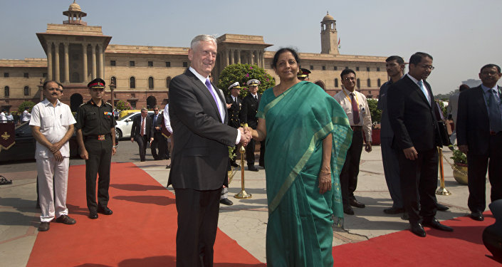 Indian Defense Minister Nirmala Sitharaman, center right, shakes hands with U.S. Defense Secretary Jim Mattis center, upon his arrival at the Defense Ministry office, in New Delhi, India, Tuesday, Sept. 26, 2017