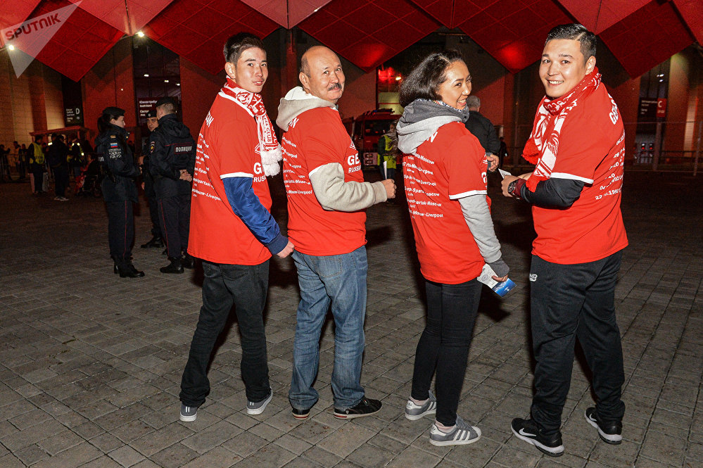 Fans are posing in commemorative T-shirts ahead of the UEFA Champions League group stage match Spartak Russia vs. Liverpool England