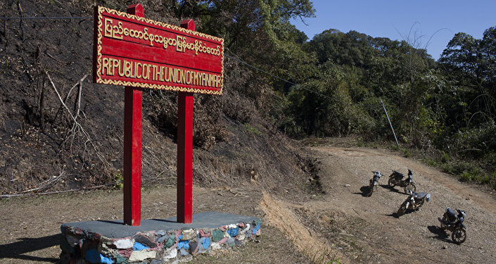 Motorcycles stand beside a sign on the border between Myanmar and India at Pangsau Pass, Saigang State, Northern Myanmar. (File)