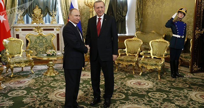 Russian President Vladimir Putin (L) shakes hands with Turkey's President Recep Tayyip Erdogan (R) ahead of their meeting in the Kremlin in Moscow, on March 10, 2017