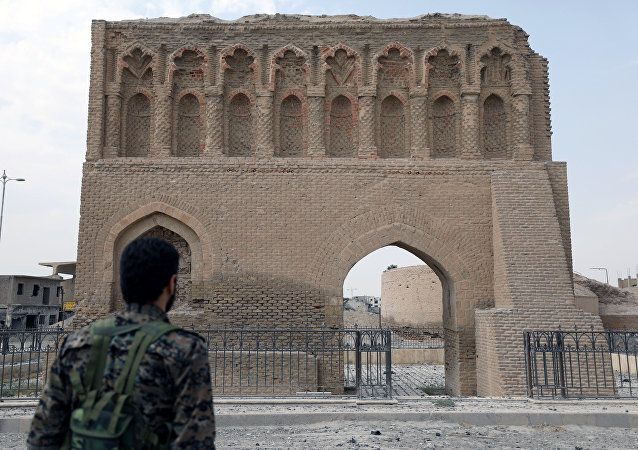 A fighter from Syrian Democratic Forces (SDF) stands near the Baghdad gate in Raqqa, Syria September 16, 2017.