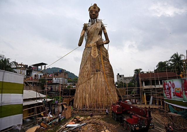 Artisans install a 100-foot bamboo idol of the Hindu goddess Durga, which is aimed at breaking the Guinness World Records for the tallest bamboo sculpture ever made, ahead of the Durga Puja festival, in Guwahati, India September 23, 2017