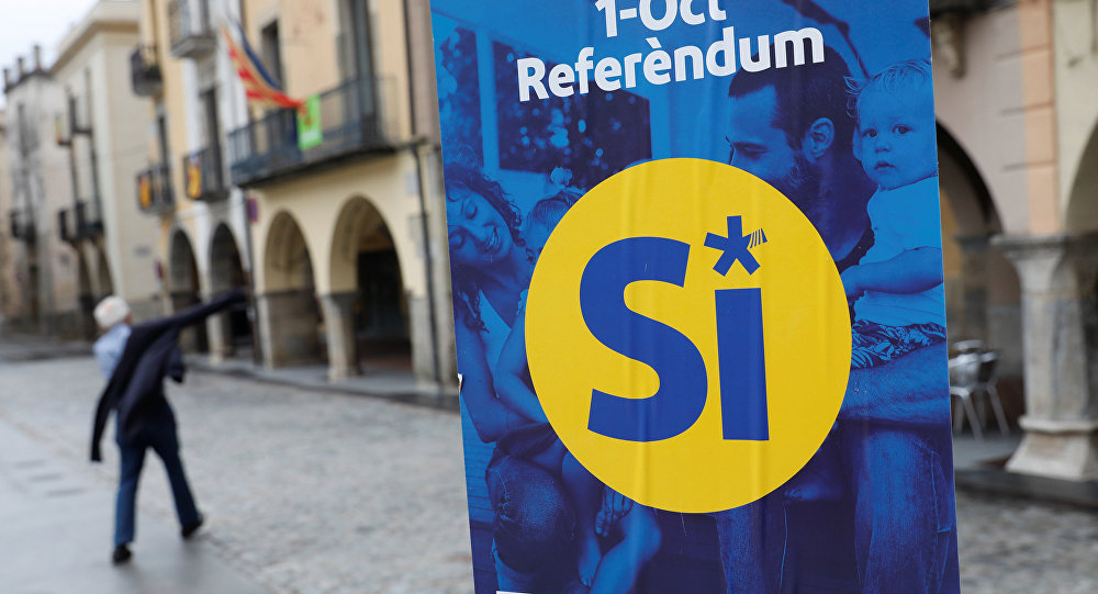 A pro-independence referendum campaign banner hangs in the birthplace of Catalan President Carles Puigdemont, the Catalan town of Amer, Spain, September 30, 2017.