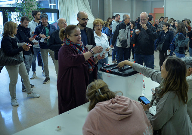 People vote at Estel school during the banned independence referendum, in the Catalan town of Vic, Spain October 1, 2017