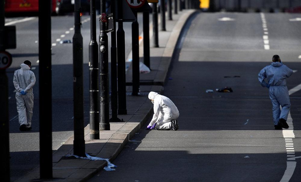 Police forensics investigators work on London Bridge after a terror attack in London, Britain, June 4, 2017.