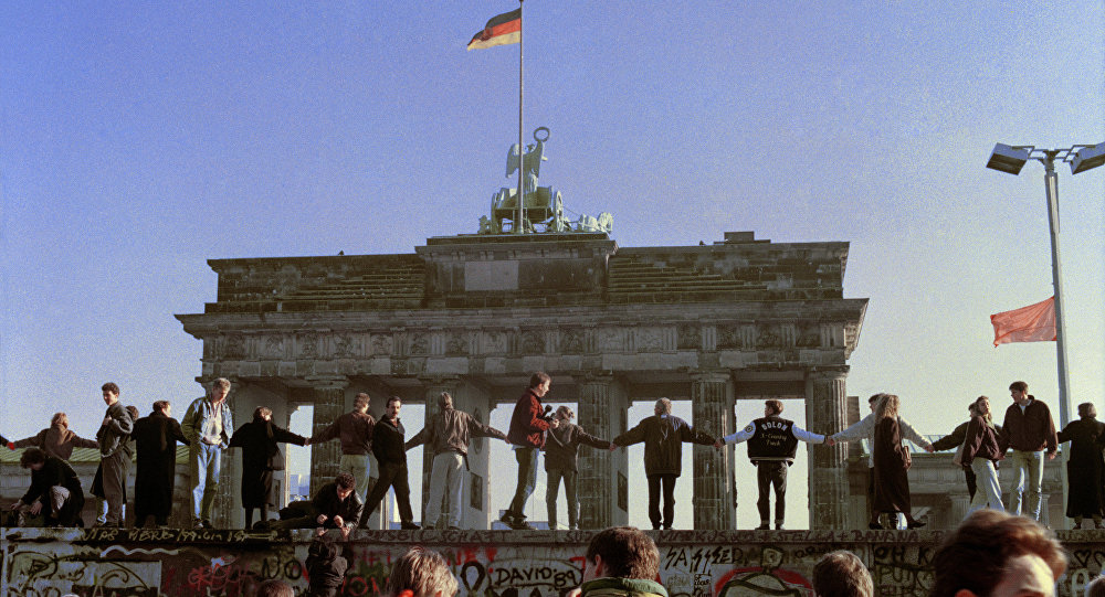 Berliners sing and dance on top of the Berlin Wall to celebrate the opening of East-West German borders, Friday afternoon, Nov. 10, 1989.