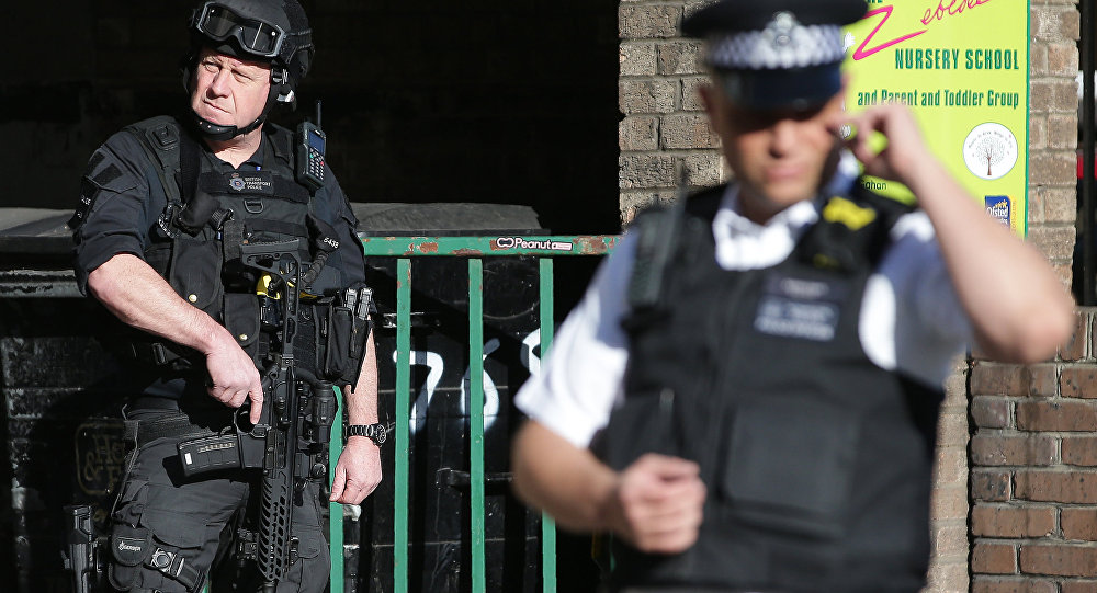 Armed British police officers stand on duty outside Parsons Green underground tube station in west London on September 15, 2017, following an incident on an underground tube carriage at the station