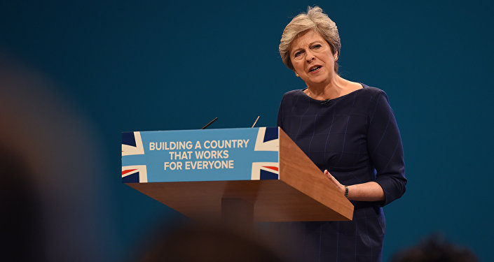 Britain's Prime Minister Theresa May delivers her speech on the final day of the Conservative Party annual conference at the Manchester Central Convention Centre in Manchester, northwest England