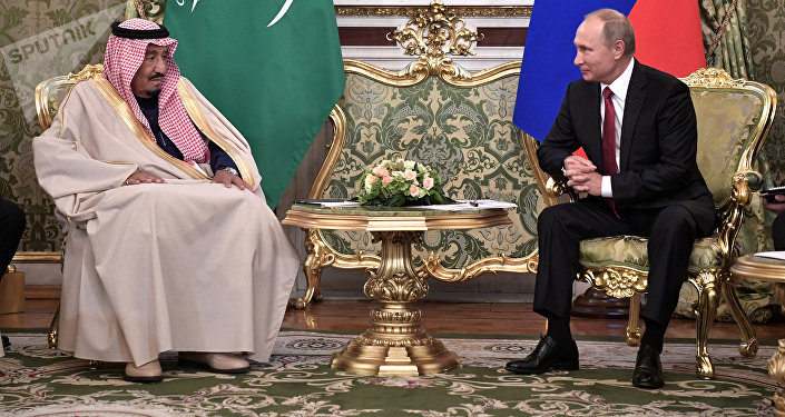 Russian President Vladimir Putin (R) meets with Saudi Arabia's King Salman in the Kremlin in Moscow, Russia