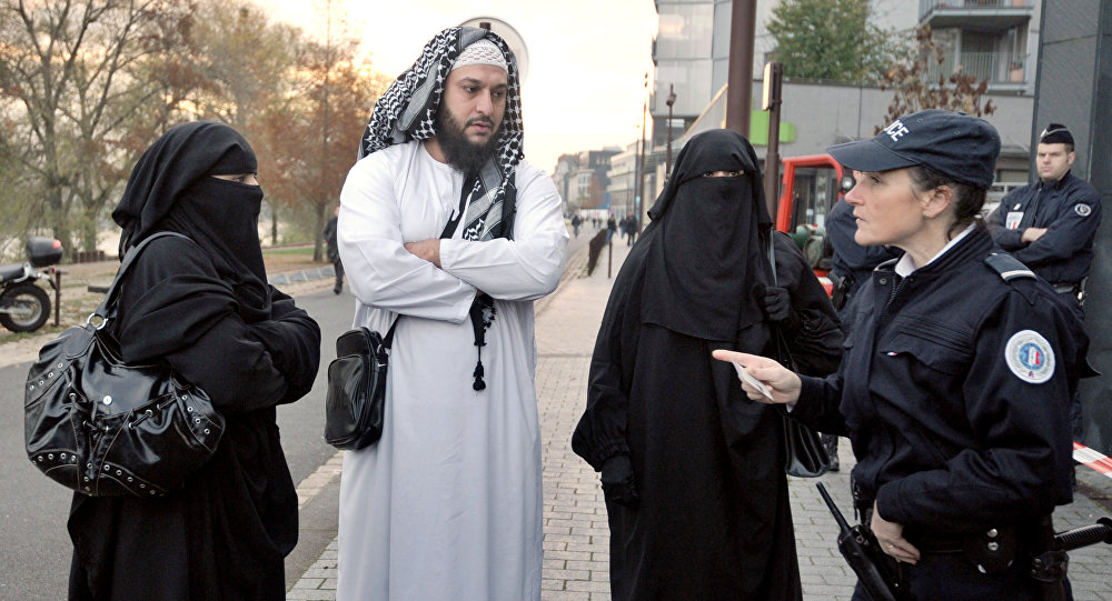French police woman carries out an identity check of a wife wearing a full-face veil. Photo used for illustration purpose