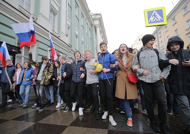 Participants in an unauthorised protest on Pushkinskaya Square, Moscow