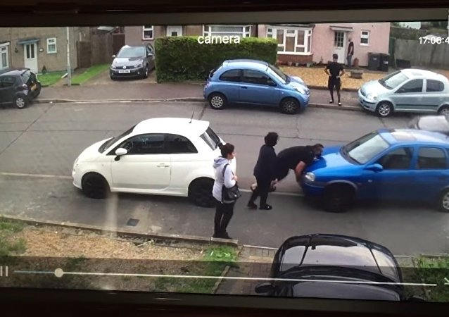 Strongman Moves Parked Car In Dispute