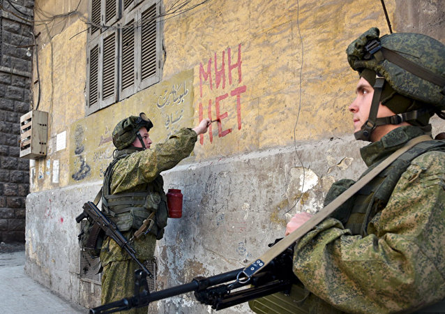 Russian servicemen conduct mine clearing in residential areas in Aleppo, Syria