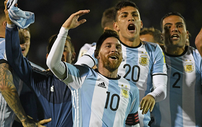 Argentina's Lionel Messi (C) celebrates after defeating Ecuador and qualifying to the 2018 World Cup football tournament, in Quito, on October 10, 2017