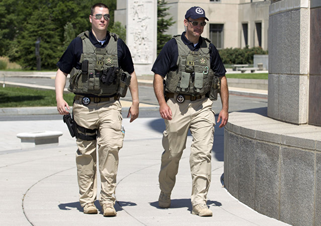 US Marshalls move outside the federal US District Court in Washington Saturday, June 28, 2014, after security was heightened in anticipation of a possible court appearance by captured Libyan militant Ahmed Abu Khattala later in the day.