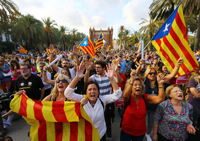 People wave separatist Catalonian flags at a rally in support of independence in Barcelona, Spain