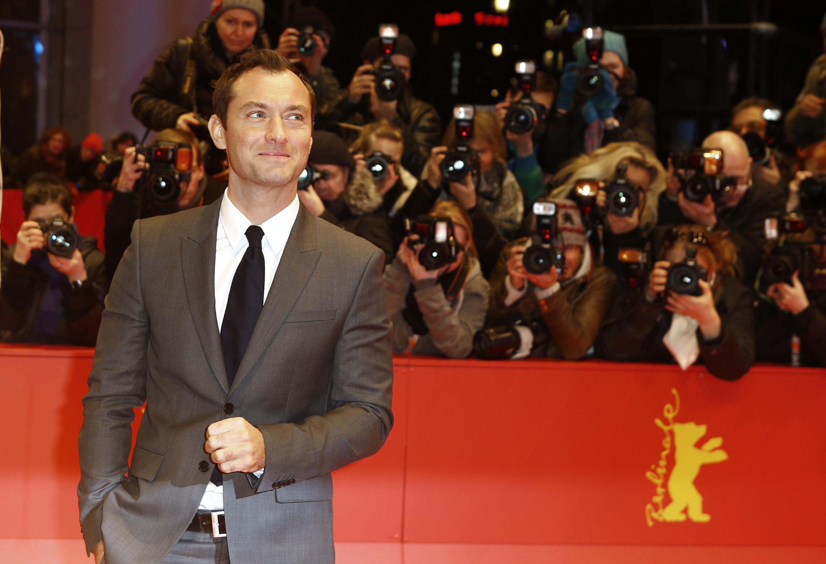 Actor Jude Law poses for photographers upon arrival at the red carpet of the film 'Genius' during the 2016 Berlinale Film Festival in Berlin