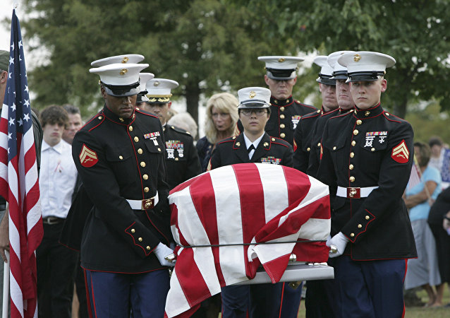 An American flag covers the casket of Lance Cpl. Christopher Fowlkes as it is carried by an honor guard during grave side services Friday, Sept. 18, 2009, in Gaffney, S.C. Fowlkes, 20, died last week from his injuries from a ground bomb on Sept. 3 battle in Helmand province, Afghanistan.